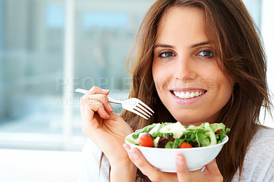 Buy stock photo An attractive young woman eating fruit salad