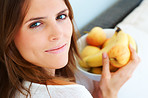 Closeup of beautiful young woman holding fruit bowl
