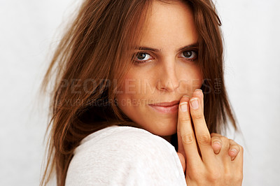 Buy stock photo Pretty young woman looking confidently