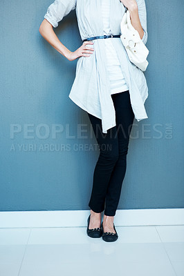 Buy stock photo Low section - Woman standing against grey backgrou