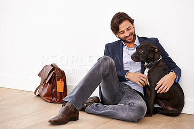 Buy stock photo A handsome businessman sitting alongside his dog