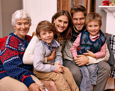 Buy stock photo A happy family with their grandmother on Christmas Eve