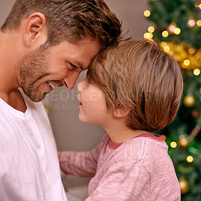 Buy stock photo A young father and his son on Christmas ece