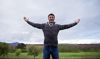 Buy stock photo A young man with arms  outstretched