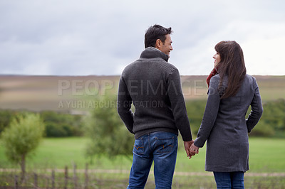 Buy stock photo Shot of a loving couple enjoying a day out together