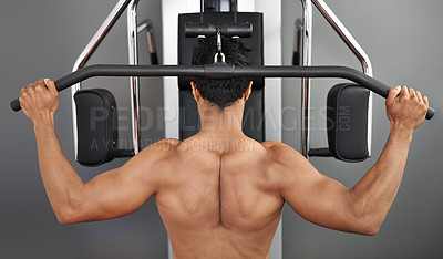 Buy stock photo Rear view of a young ethnic man working out at the gym