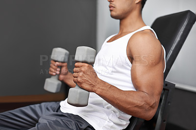 Buy stock photo Side view of a muscular man lifting dumbbells