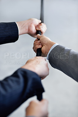 Buy stock photo Closeup studio shot of two businessmen pulling a rope