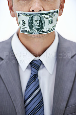 Buy stock photo A businessman with his mouth covered with paper money