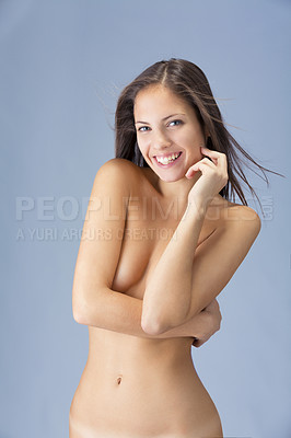 Buy stock photo Studio shot of a gorgeous naked model against a blue background