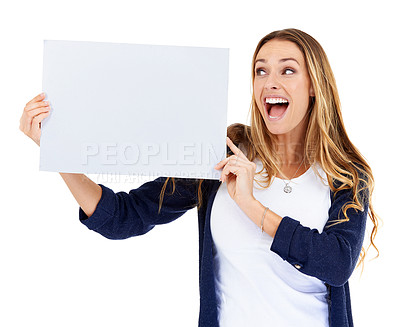 Buy stock photo A young woman looking excitedly at a blank placard