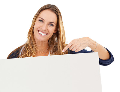 Buy stock photo Studio shot of a smiling woman pointing to a blank sign for copyspace