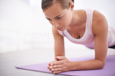 Buy stock photo An attractive young woman working out