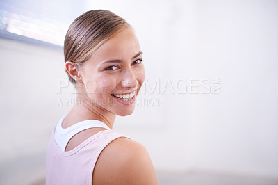 Buy stock photo A cropped shot of an attractive young woman in gym wear looking over her shoulder