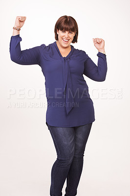 Buy stock photo Portrait of a pretty young woman with her arms raised in victory on a white background