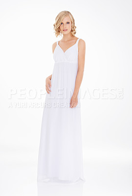 Buy stock photo Studio shot an attractive young woman in white dress