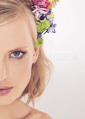Buy stock photo Portrait of an attractive young woman with beautiful flowers
