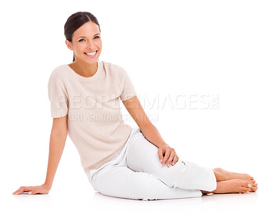 Buy stock photo Studio shot of a casually dressed young woman relaxing on the floor