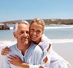Mature couple enjoying a sunny day at the beach