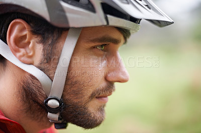 Buy stock photo Closeup profile of a cyclist wearing a helmet