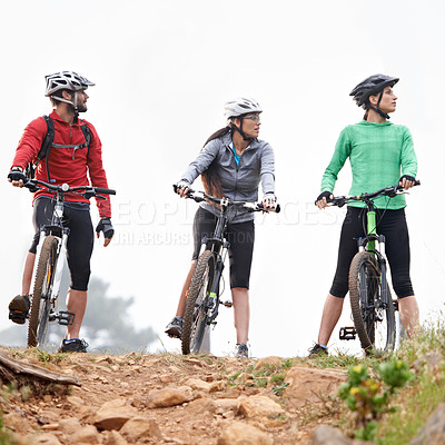 Buy stock photo A group of young cyclists about to ride on a rocky trail