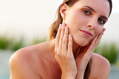 Buy stock photo Pretty young woman touching her face