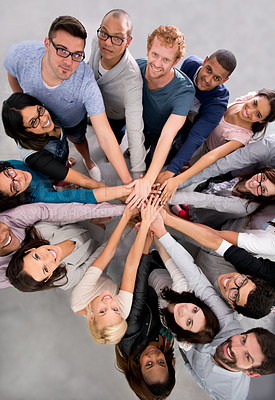 Buy stock photo High angle shot of a group of businesspeople with their hands in a huddle
