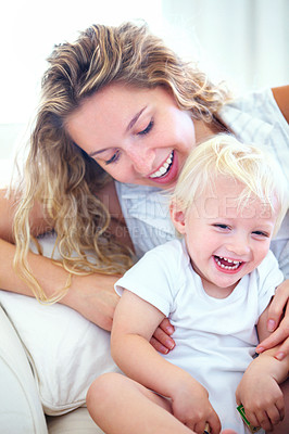 Buy stock photo Cropped shot of an affectionate young mother with her baby boy