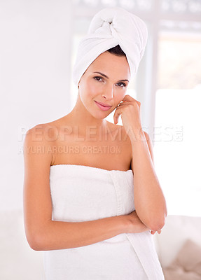 Buy stock photo A beautiful woman standing with her towel wrapped around her body