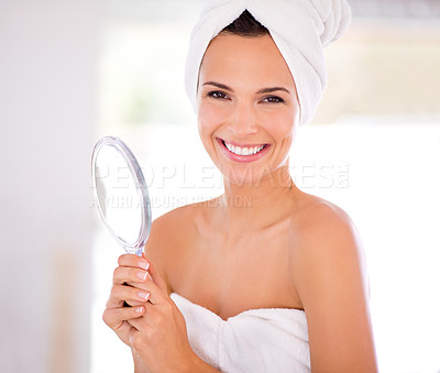 Buy stock photo A beautiful woman smiling while holding a hand mirror