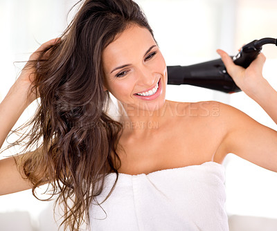 Buy stock photo Closeup shot of a beautiful woman drying her hair with a hairdryer
