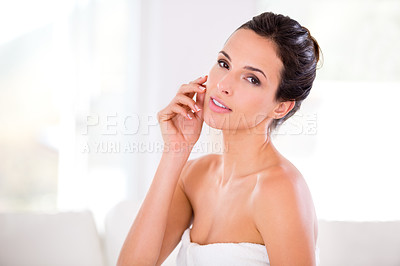 Buy stock photo Portrait of a beautiful woman caressing her flawless skin