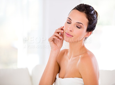 Buy stock photo A beautiful woman caressing her flawless skin