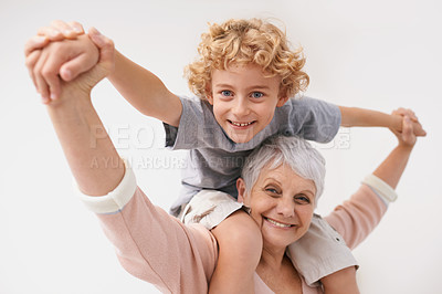 Buy stock photo Shot of a grandmother giving her grandson a piggyback ride