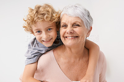 Buy stock photo Portrait of a grandmother giving her grandson a piggyback ride