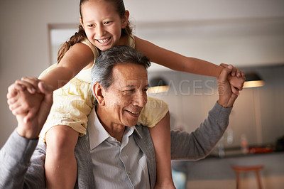 Buy stock photo Shot of a grandfather giving his little granddaughter a piggy back