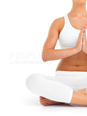 Buy stock photo Cropped shot of a woman meditating against a white background
