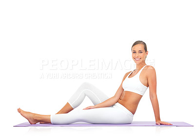 Buy stock photo Portrait of a young woman sitting on a yoga mat