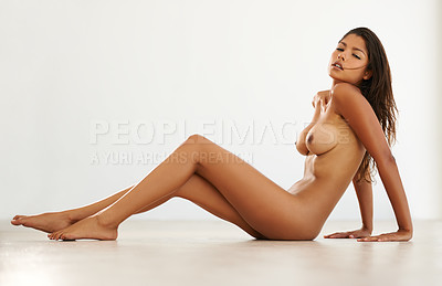 Buy stock photo Studio shot of a sexy young woman posing seductively