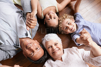 Buy stock photo High angle shot of a brother and sister bonding with their grandparents