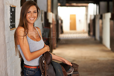 Buy stock photo A young woman posing in a stable