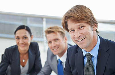 Buy stock photo Portrait of three businesspeople sitting together