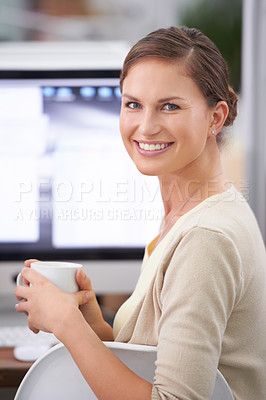Buy stock photo Portrait of a young attractive businesswoman enjoying a cup of coffee at her desk