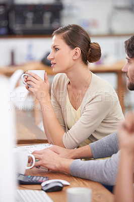 Buy stock photo Shot of a young attractive businesswoman enjoying a cup of coffee at her desk