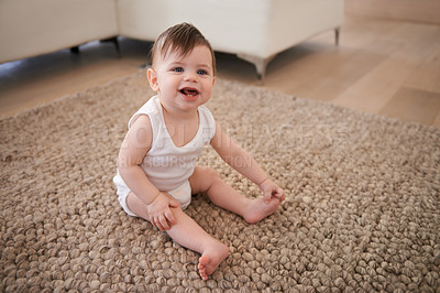 Buy stock photo A baby boy sitting on the carpet at home