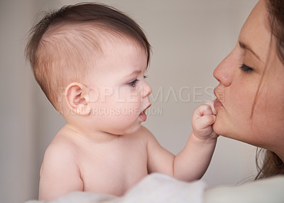 Buy stock photo Cropped shot of a mother holding her baby boy