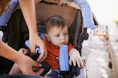 Buy stock photo Cropped shot of a baby boy being put into a baby carriage