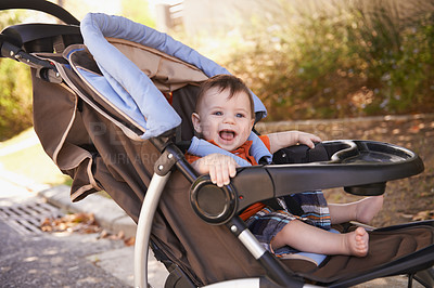 Buy stock photo Portrait of a baby boy sitting in a stroller