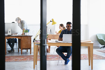 Buy stock photo Shot of young professionals working in an office