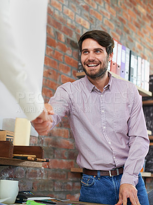 Buy stock photo A young man shaking a co-worker's hand